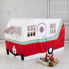 Fun canvas Jetaire camper playhouse for kids at Land of Nod now on sale. The fire is safe! But don't be surprised if the kids beg for s'mores.