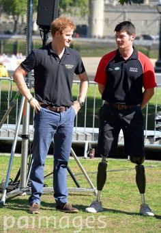 Prince Harry speaks with Captain Dave Henson during the announcement of the 130-strong British team for the Invictus Games in Potters Field Park, London.