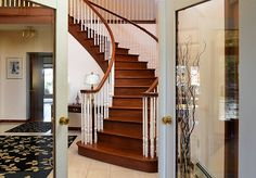 Foyer with curved staircase and French doors.