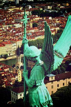 Angel statue on the Basilica of Notre-Dame de Fourvière, Lyon, France