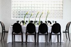 Modern table setting design with black chairs. Find more ideas for how to plan an 80s party http://sparklerparties.com/rock-the-80s/