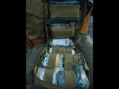 Combat Medical Pouch  Combat Medical Pouch and contents. This pouch is on my Plate Carrier to be used as an IFAK . All the items where carefully selected to fit my need in the line of fire.
