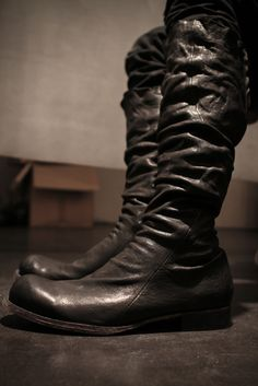 black leather boots by Obscur