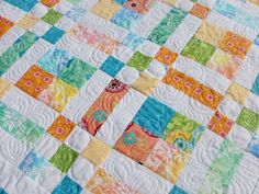 Patches Baby Quilt.  I love the softness of this quilt.  There is beautiful free motion quilting designs throughout.