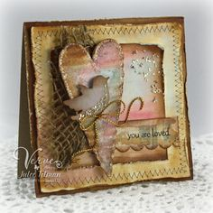 Grunged Love Card...with inked & stitched papers, glitter heart, netting, & bird.