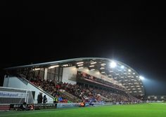 Fleetwood Town battled back from two goals down to snatch a point off league leaders Bristol City.