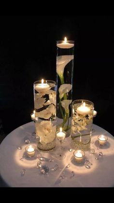 Floating candles with flowers centerpieces