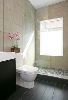 Large format tiles can create an illusion of spaciousness.
