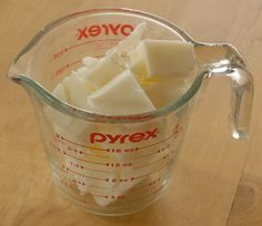 White melt and pour glycerin soap base cut into chunks and placed in a Pyrex® measuring cup.