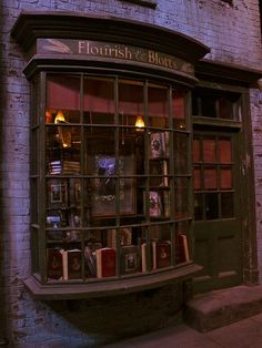 Flourish and Blotts::Diagon Alley. Love everything about this window
