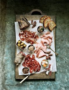rustic platter, parchment, an assortment of salami, olives, etc...  Simple & lovely