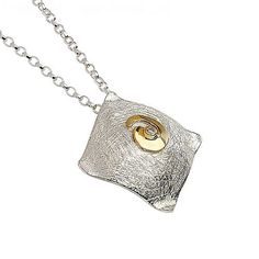 Square sterling silver and 18k gold vermeil pendant with feature Irish Swirl.  Metal: Silver