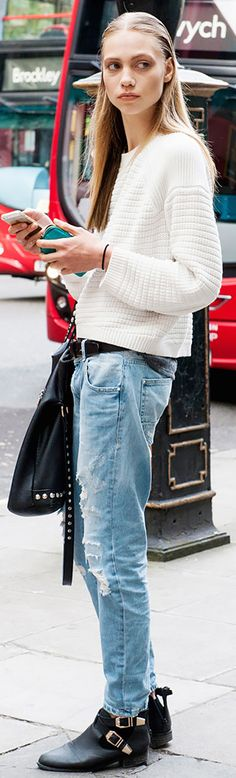 White knit sweater, baggy ripped jeans, and black ankle boots