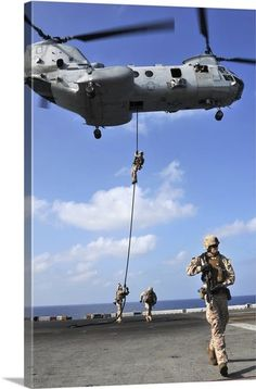 Marines fast rope from a CH-46 Sea Knight helicopter