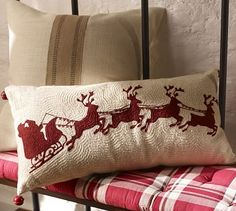 """Sleigh Bell Crewel Embroidered Lumbar Pillow #potterybarn.  Victorian cut-paper silhouettes, with their crisp lines and intricate details, inspired the merry scene embroidered on our pillow. Red sleigh bells jingle at the corners.  12 x 24"""". Pure cotton."""