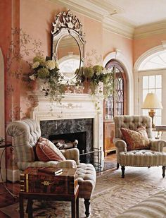 Everything about this room - hand painted peach wall, rug, fireplace, mirror, mantle, end table, chairs . . . . .