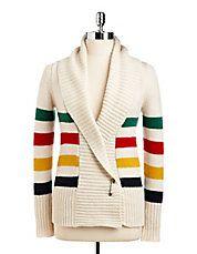 "<ul> <li>Soft layered pullover detailed with prim shimmering collar</li> <li>Peter Pan collar</li> <li>Long sleeves with contrast cuffs</li> <li>Back keyhole with hook-and-eye closure</li> <li>Layered hem</li> <li>About 26.5"" from shoulder to hem</li> <li>Acrylic/polyester</li> <li>Dry clean</li> <li>Imported</li> </ul>"