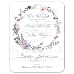 Watercolor wildflowers wedding save the date card with photo template has a beautiful wreath of wildflowers and greenery in shades of smokey blue, lavender purple, plum, peach, taupe and green on a white background.