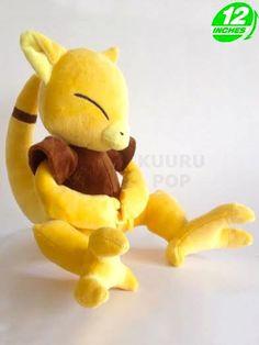 Pokemon Abra Plush  Catch Abra before it teleports away! The psychic-type Pokemon looks perfect as a cuddly plush.