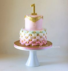 pink, mint, and gold first birthday cake with billows and one topper