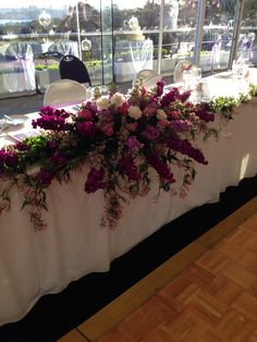 Bridal table flowers- cascading waterfall design using stock, roses and jasmine for a lovely romantic garden themed wedding. Colour palette purple pink and white. Created by Jewel Phon Flowers. www.jewelphonflowers.com.au