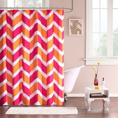 The Mi Zone Billie shower curtain gives a modern touch and a pop of color with its bright colorblock pattern in a chevron design. Made from microfiber, this curtain is machine washable for easy care.