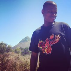 One Young World Ambassador Khethelo Xulu wearing RAR at Signall Hill, Cape Town