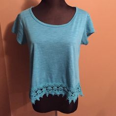"Crochet Crop Top EEUC and worn once. This crop top is perfect for summer! It is a gorgeous teal color with a crochet bottom. Front measurement is 18"" from the shoulder to the chest. Rewind Tops Crop Tops"