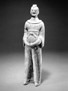 Standing Official Period: Northern Wei (386–534)–Northern Qi (550–577) Dynasty  Date: mid-to-late 6th century Culture: China Medium: Earthenware with traces of pigment. @Matt Valk Chuah Metropolitan Museum of Art