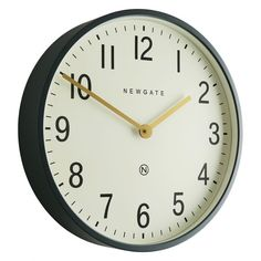 The Edwards dark grey wall clock's combination of straight-cut, matt-painted metal case and a cream dial gives it a clean, contemporary look.[br]The clock has simple black Arabic numerals and brass linear hands and a flat glass lens; it is also available with a brass case and blue dial.