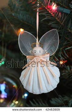 homemade angel ornaments | ... stock-photo-homemade-christmas-tree-shell-angel-ornament-42463909.jpg