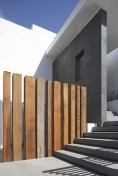 A Rustic Wooden Partition With The Concrete Staircase Step For Modern White Residence In The Suburbs Of Sydney Three-Storey Residence with Glass Facade in the Suburbs of Sydney Home design