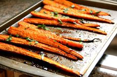 Balsamic Roasted Carrots: 6-8 medium carrots, peeled and sliced lengthwise down the center, making 12-16 pieces,   salt and pepper,   1/4t freshly grated nutmeg,   1T balsamic vinegar,   1t brown sugar,   2T olive oil,   fresh parsley, chopped