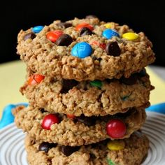 Monster Cookies (no flour): 1 1/2 cups creamy or chunky peanut butter, 1 cup packed light brown sugar, 1 cup granulated white sugar, 8 tablespoons (1 stick) unsalted butter, softened, 3 large eggs, 1 tablespoon vanilla extract, 4 1/2 cups quick cooking oats, 2 teaspoons baking soda, 1 cup semi-sweet chocolate chips, 1 cup M's plain chocolate candies