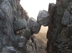 China: Bridge of the Immortals formed by 5 large boulders collapsing between 2 cliff walls.