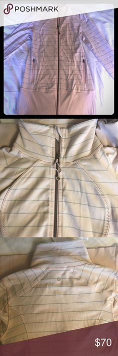 Lululemon jacket Lululemon Jacket. Light pink in color with grey stripes. Hard to show color in pics. I believe it is the Define jacket. Nice and long for coverage. Fits like a size Medium. Either a 6 or 8. lululemon athletica Jackets & Coats