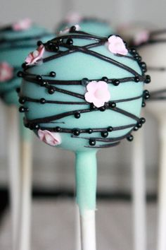 Turquoise cherry blossom cake pops- pretty much the color scheme I want for my cake but I want the branches a dark brown