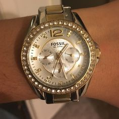 Fossil Silver and Gold Watch Gold and silver Fossil watch with rhinestones. Needs a new battery and has average wear marks Fossil Accessories Watches
