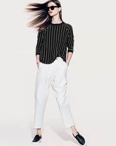 NOV '14 Style Guide: J.Crew women's pinstripe side slit sweater, Collection draped pant, and Vans perforated leather slip-on shoes.