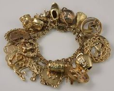 Charm Bracelet, 14K Yellow Gold, With 32 Charms