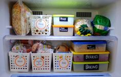 An organised freezer using labelled containers and pull-out baskets so that everything can easily be accessed and found. Click through for more freezer organisation ideas