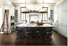 black island in a white kitchen...I just love the openness of this space. Very inviting!