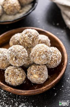 Easy energy bites with made with coconut, instant oats and flavored with cardamom. These Coconut Cardamom Energy Bites are vegan and refined sugar free.   Find the recipe on www.cookwithmanali.com