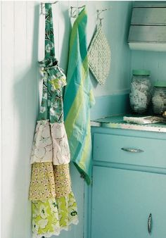 apron, paint color & vintage glass canisters. <--i say yes to it all.