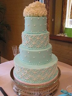 Aqua wedding cake with white geometric circular pattern. All buttercream wedding cake. www.VintageBakery.com  (803) 386-8806