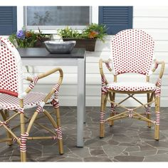 The beloved European bistro chair assumes a coastal cottage vibe in the red and white Hooper indoor outdoor stacking armchair by Safavieh