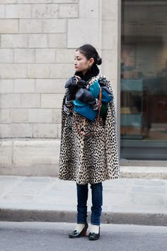 I wish I had the guts to wear this awesome animal print cape.