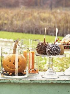 Pumpkin Table Decor:  Tuck candles and small pumpkins inside glass cylinders or canning jars. Chocolate- and caramel-covered apples make toothsome favors.