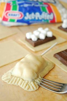 "S'more Cookies: Use refrigerated sugar cookie dough! Just roll out the dough, place your chocolate in the center and as many marshmallows as you would like then place another piece of dough over the top and ""crimp"" the edges. Add a sucker stick if you want and make it a cookie on a stick. Bake using cookie dough heating instructions."