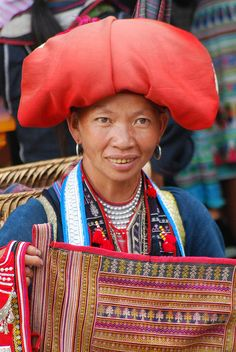 The Red Dzao hill tribe, one of Vietnam's ethnic minorities, traditionally wears a red head covering. The size of a woman's hat is an indicator of her wealth. Red Dzao lady, Sapa by IainDMatthews, via Flickr  #Vietnam   #Asia   #travel   #culture